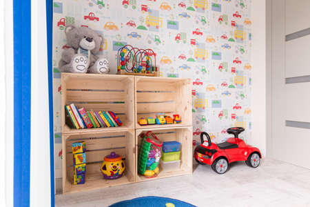 wall paper: Light and cosy bedroom with teddy bear, toy cars and colourful wall paper