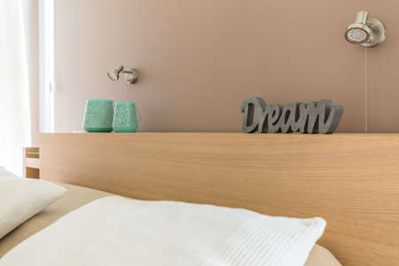 wooden bed: Close up of a wooden bed with a headboard