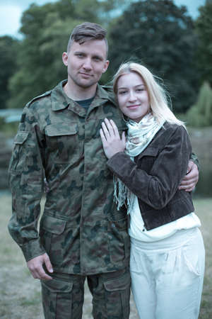 path to romance: Lovely portrait of a smiling young soldier and his wife Stock Photo