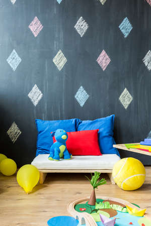 interior room: Room interior  with small seat, cushions, balloons, toys and wall with the diamond theme Stock Photo