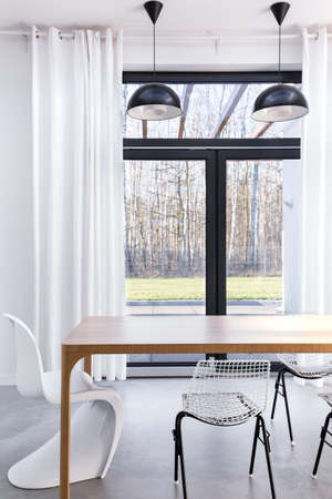 lightsome: Part of a dining room with a dining table and view of the garden