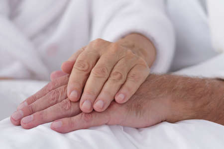 old hand: Loving marriage- close-up of elderly hands holding together