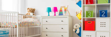bight: Modern white furniture in colorful baby room interior