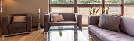 living room window: Modern interior with comfortable living room set and big window, panorama