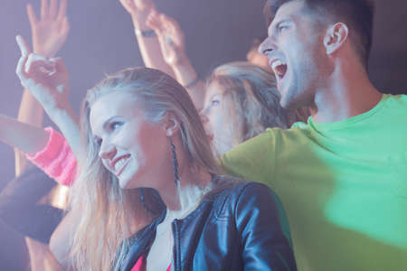 group shot: Shot of a group of young people having fun at a rock concert