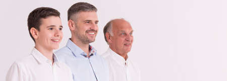generation: Portrait of three generation of men, white background, panorama Stock Photo