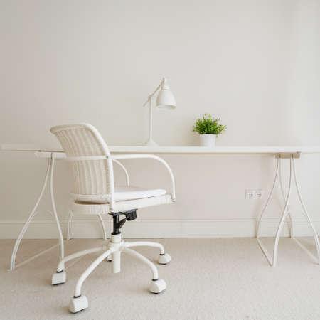 working space: White empty desk in stylish retro interior