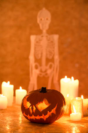 Halloween ornaments with skeleton on wall and pumpkin lantern