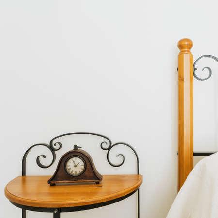 bedside: Elegant bedside table in the bedroom, horizontal Stock Photo