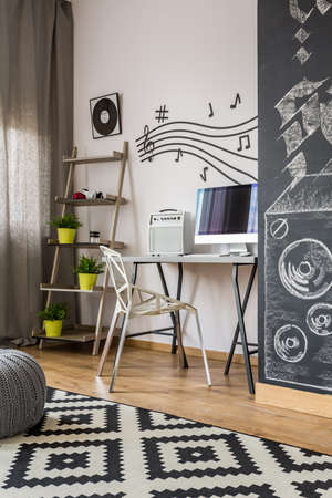 wall decor: Modern home office with desk, new chair, wall decor, blackboard wall and pattern carpet