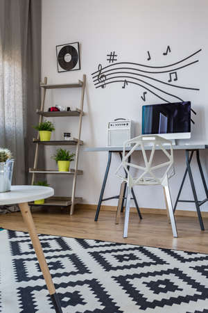 room decoration: Black and white modern home office with a music wall decor
