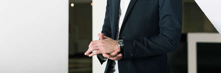 graduation suit: Close-up of stressed mans hands. Elegant man in suit before important interview