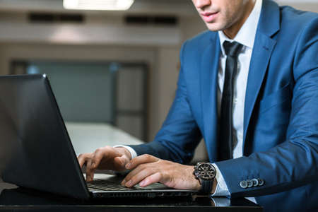 professionalist: Closer shot of an elegant businessman working using the laptop Stock Photo