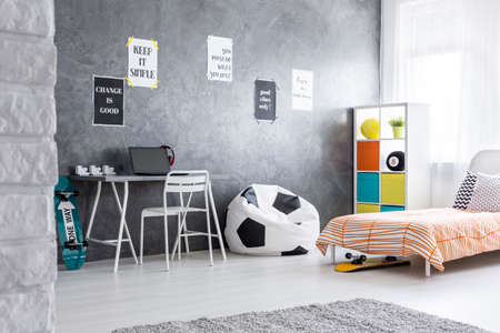 bean bag: Spacious teenager room with bean bag chair, bed and desk
