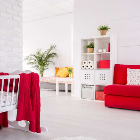 cosy: Shot of a cosy creative studio apartment with a crib