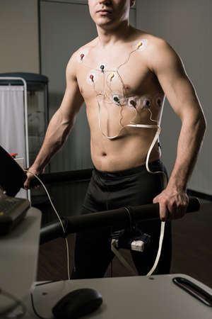 stress test: Cropped shot of a shirtless man during his cardiac stress test
