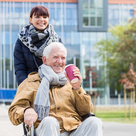 grandad: Image of senior man with walking problem and his carer