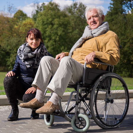 grandad: Image of private nurse and her patient with walking problem