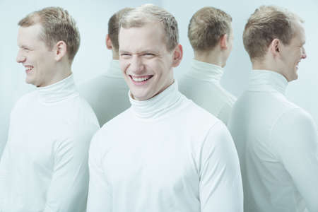 lunacy: Man smiling in a mean way, surrounded by his mirror reflections