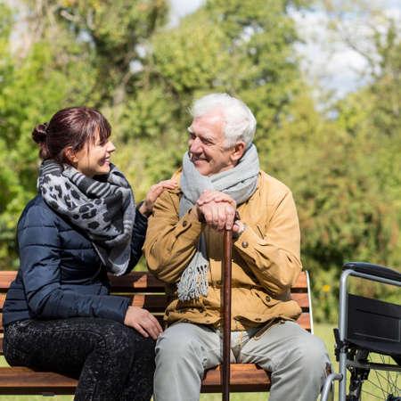 elder tree: Elder man and carer in the park