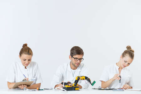 technical university: Shot of three technical university students focused on their work