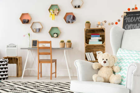 comfort room: Cozy child room with comfortable chair and place for creative work