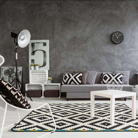 Spacious classic living room in black and white. Interior designed with style