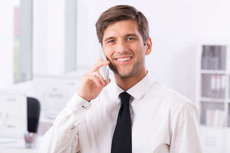 telephone call: Shot of a young handsome businessman talking over his phone Stock Photo