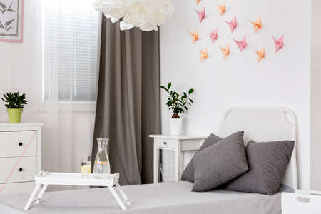 wall decor: White bedroom with grey details and origami wall decor