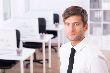 Portrait of a young serious businessman in an office Stock Photo