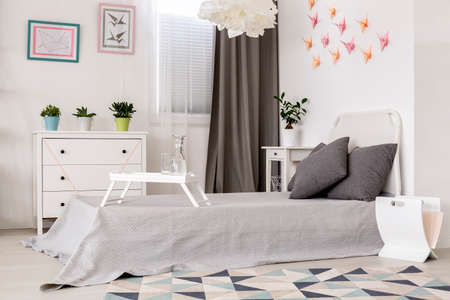 wall decor: Light bedroom with simple white furniture and origami wall decor