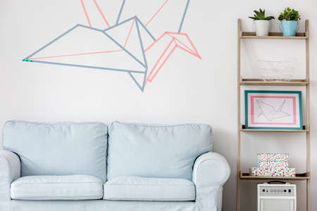 Light living room with sofa, DIY regale and washi tape wall decor Archivio Fotografico