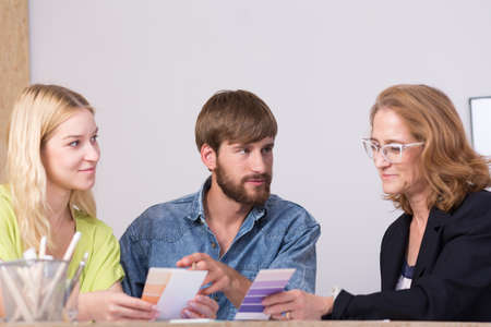 ides: Interior designers discussing new ideas at the table Stock Photo