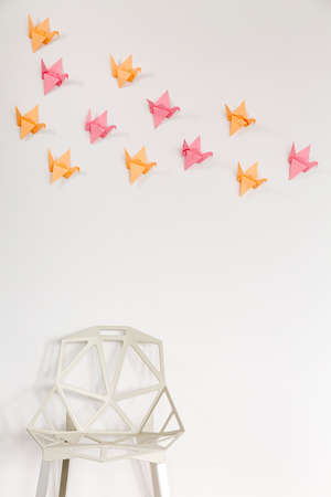 interior wall: Light home interior with modern crystal chair and origami wall decor