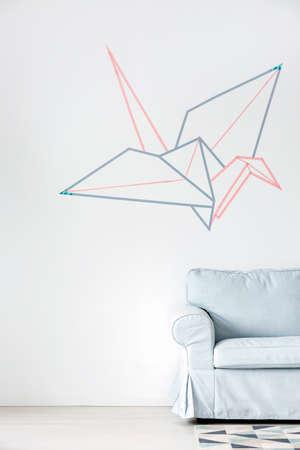 wall decor: Light home interior with sofa and washi tape wall decor Stock Photo