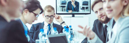 deliberation: Business people having meeting with video conference