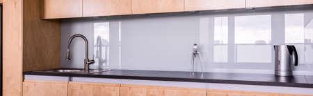 chrome base: Modern minimalist kitchen with wooden base cabinet