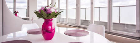 luxury apartment: Pink decorations in bright modern dining room