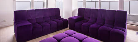 living room furniture: Comfortable living room desing and violet furniture Stock Photo
