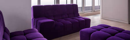 couches: Violet quilted couches in modern spacious apartment