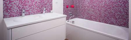 bathroom tiles: Modern bathroom with white furniturte and pink tiles