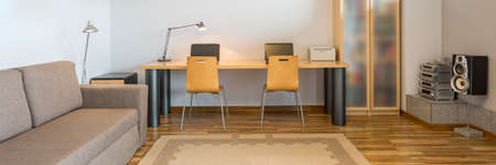 home office: Panoramic picture of a modern spacious home office Stock Photo