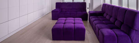 hassock: Modern living room with violet luxury furniture Stock Photo