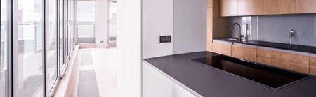 luxury apartment: Panorama wooden kitchen design in luxury apartment