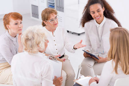 patrimony: Office interior with five women talking about the business