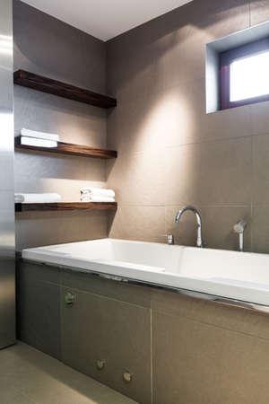 bathroom tiles: Modern bathroom with concrete tiles and big bath Stock Photo