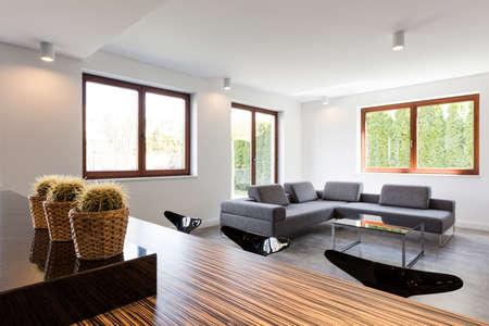 grey house: Minimalist grey corner settee in bright modern house