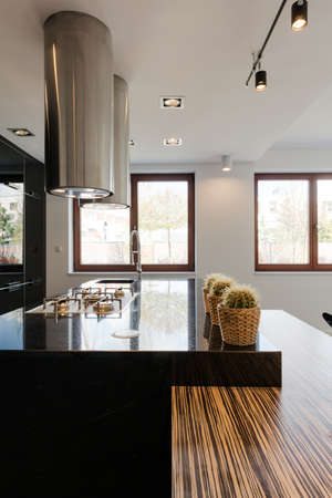 shiny black: Shiny black countertop with brocade in exclusive kitchen Stock Photo