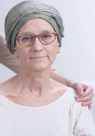 chemotherapy drug: Elderly woman recovering after chemotherapy and supporting hand Stock Photo