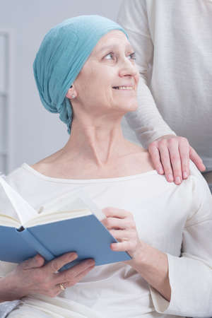 strengthen hand: Cancer patient after chemotherapy relaxing with book Stock Photo